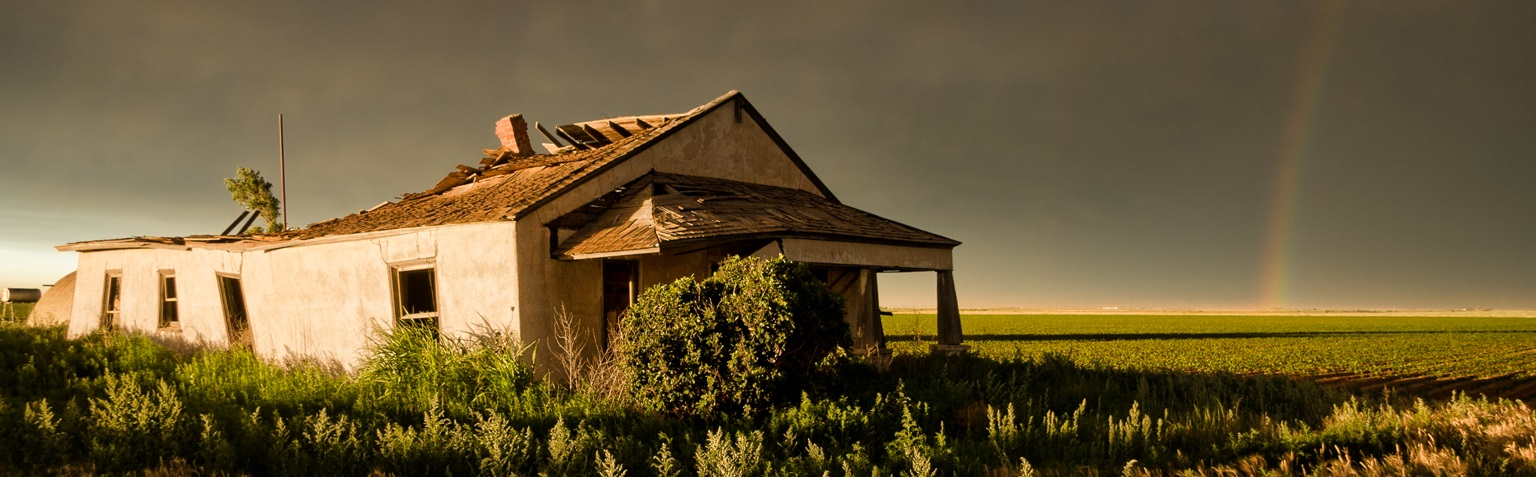 Old house with a rainbow in background